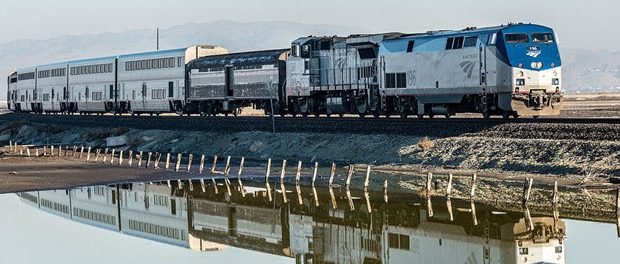 The southbound Coast Starlight passes Alviso Marina north of San Jose in December 2013 by Don DeBold from San Jose, CA, USA via Wikimedia Commons