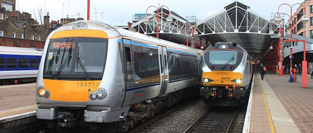 A pair of Chiltern Railway services at London Marylebone, ready for their journeys to Birmingham Snow Hill. On the left is an eight-car multiple unit with 168217 in the lead which is just about to depart; on the right is a locomotive-hauled set powered by 68010 which will follow in half an hour